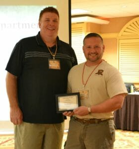 Franchisee Clint Finch and CEO Michael Plummer Jr.